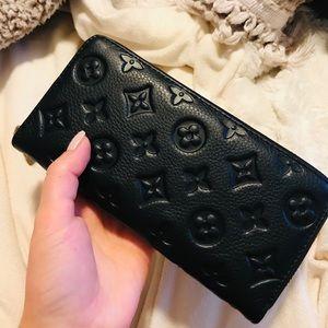 Handbags - Genuine black leather wallet with design imprint